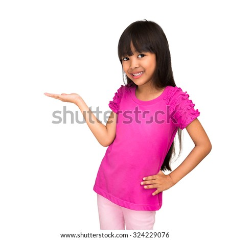 Little asian girl standing with her hand up against white background place your product here