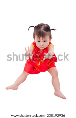 Little asian girl (thai) in traditional chinese dress, cheongsam is typical china dress, identity culture of Chinese New Year festival. Child show her hands. Isolated on white background - stock photo