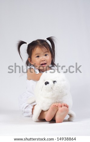 little asian girl with a seal bear - stock photo