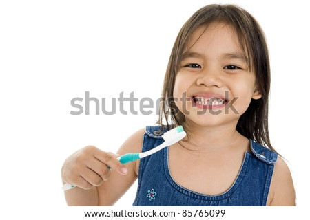 little asian girl with toothbrush over white background - stock photo