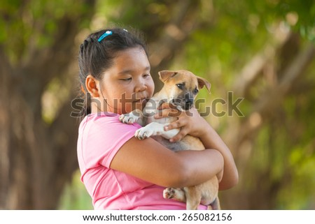 little asian girls and puppy in the garden