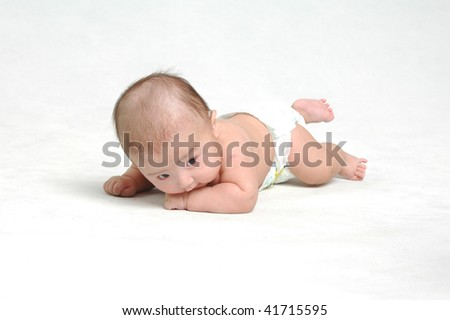 little Asian infant baby boy lying down in white background