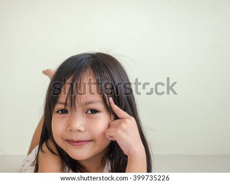 Little asian kids girl lying on the floor and thinking something