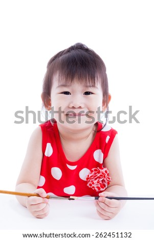 Little asian (thai) child happily, pretty girl looking at the camera and smiling, holding a paintbrushs, Concepts of creativity and education. Isolated on white background. Studio shot - stock photo