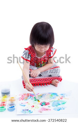 Little asian (thai) girl painting and using multicolored drawing instruments (watercolor paints, paintbrush), creativity learning education concept, on white background, studio shot - stock photo