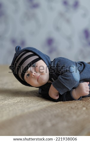 Little baby boy at home - stock photo