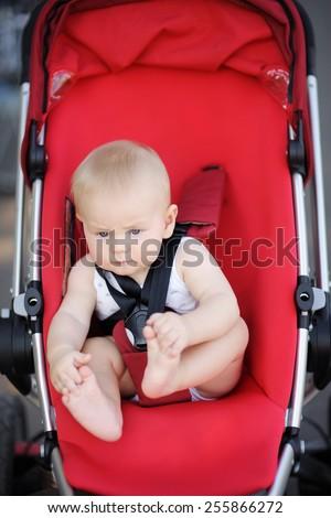 Little baby boy in stroller - stock photo