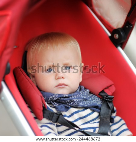 Little baby boy in stroller at the spring day