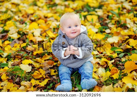 Little baby boy in the autumn park  - stock photo