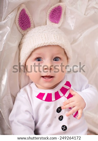 Little baby boy is in the suit of rabbit - stock photo