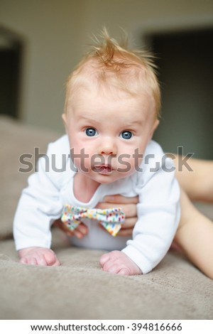 little baby boy lying on soft blanket in room - stock photo