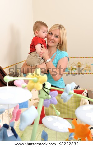 Little baby boy playing with his mother in his room - a series of BABY images. - stock photo