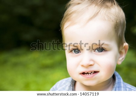 Little Baby Boy Relaxing Outdoors - stock photo