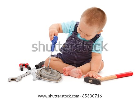 Little baby boy sitting and playing with real tools