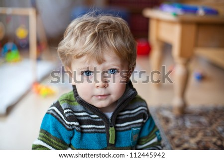 Little baby boy with blue eyes and blond hairs - stock photo