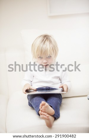 Little baby boy with tablet