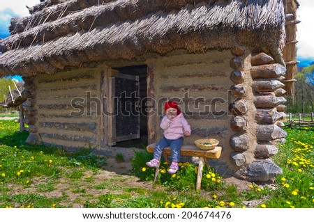 little baby from the historic huts - stock photo