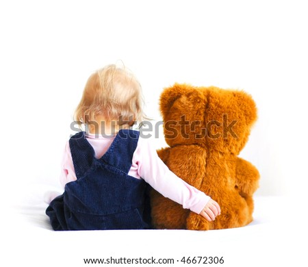 Little baby girl and teddy bear - stock photo