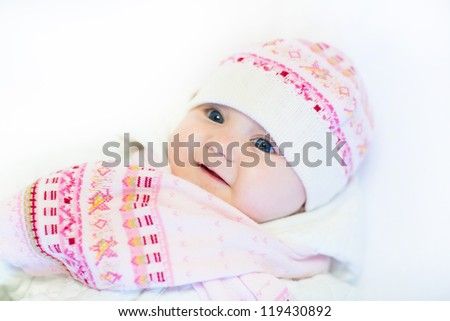 Little baby girl in a pink hat and scarf - stock photo