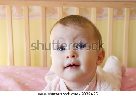 Little Baby Girl in crib, looking up