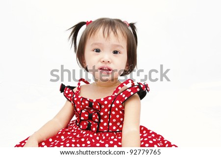 Little baby girl in red dress - stock photo