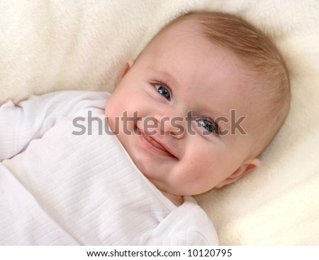 Little baby girl laughing - stock photo