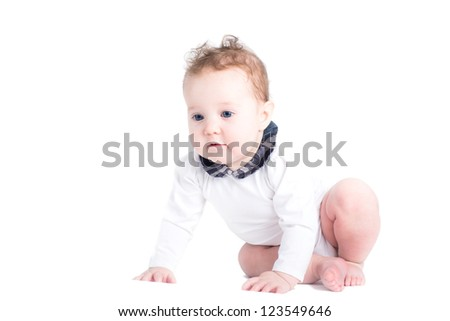 Little baby girl learning to crawl, isolated on white
