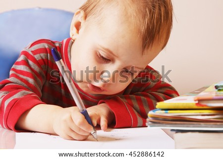 little baby girl learns to write (development, training, education) - stock photo