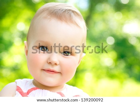 Little Baby Girl Portrait outdoor. Cute Child over nature background looking at camera - stock photo