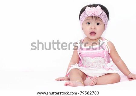 Little baby girl sitting - stock photo