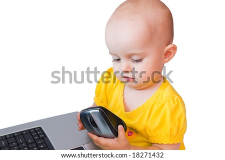 Little baby girl studies a laser wireless mouse, isolated on white - stock photo