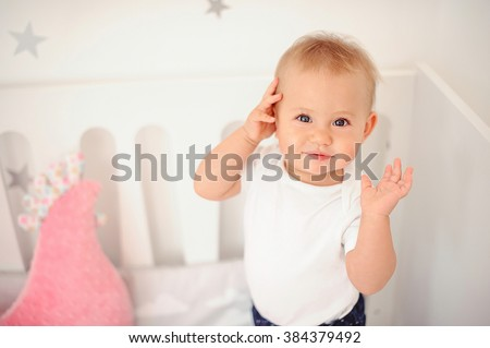 Little baby girl with a pink toy chicken - stock photo
