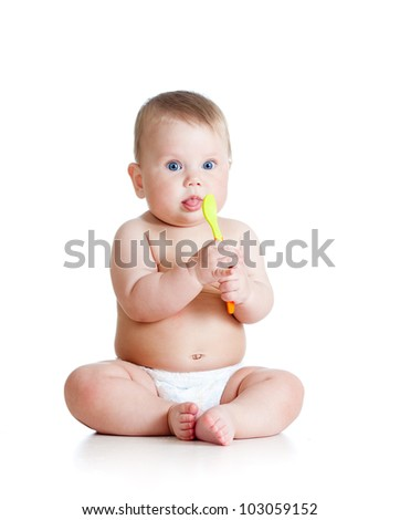 Little baby girl with a spoon - stock photo