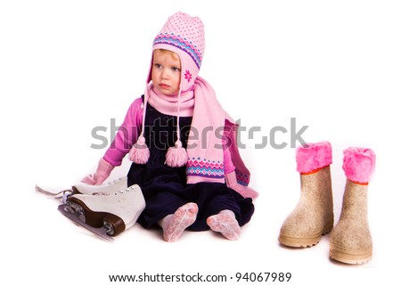 Little baby girl with figure skates over white background - stock photo