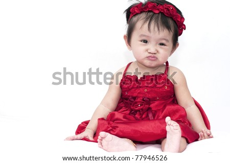 Little baby girl with funny expression