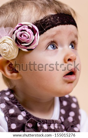 Little baby girl with headband - stock photo