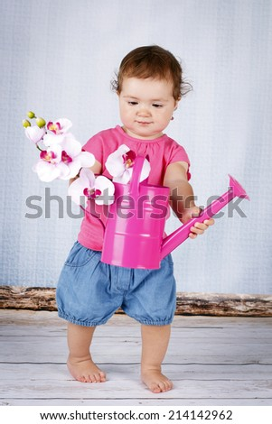 Little baby girl with watering can