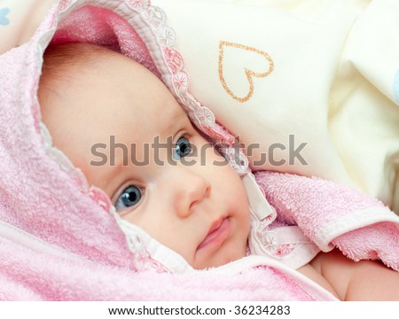 Little baby girl wrapped in pink towel after bath - stock photo