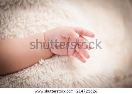 little baby hand gesturing - stock photo