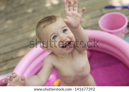 Little baby in plastic pool
