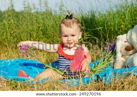 Little baby is resting in nature - stock photo