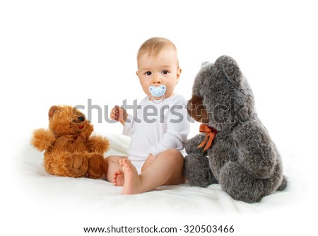 Little baby isolated on white background with teddy bear - stock photo