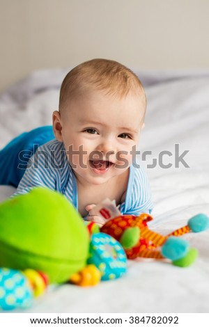 little baby laughs - stock photo