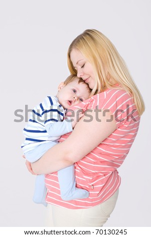 Little baby lying at his mother`s breast - stock photo