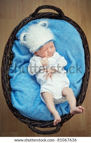 Little baby lying in a basket