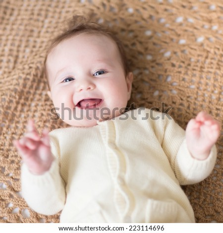 Little baby on a knitted blanket - stock photo