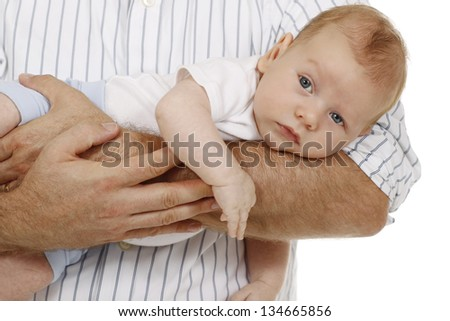Little Baby on the arm of its father - stock photo
