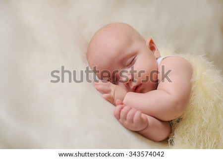 Little baby on the bed at home sleeping - stock photo