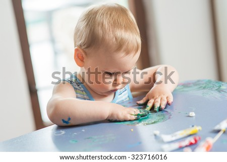 Little baby painting - stock photo