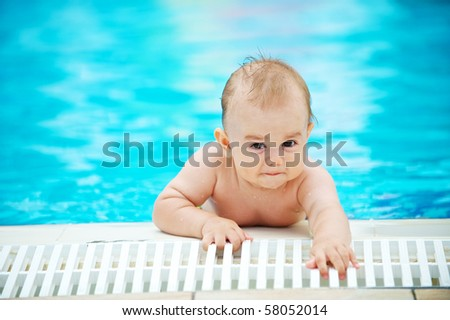little baby playing in the pool - stock photo